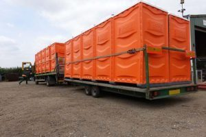 7.5tonne HGV transporting portable toilets with trailer