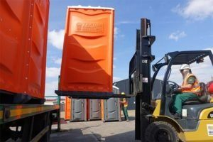 unloading plant hire, portable toilets with forklift